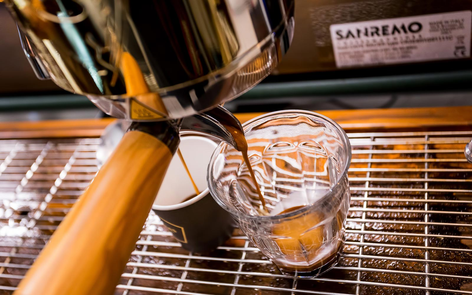 Expert baristas using the best available coffee machines
